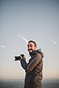 Portrait of a photographer with funny expression - RAEF000956