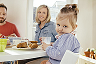 Portrait of little girl with glass of milk at breakfast table - MFF002876