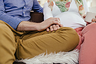 Hands of man touching hands of his pregnant girlfriend - MFF002879