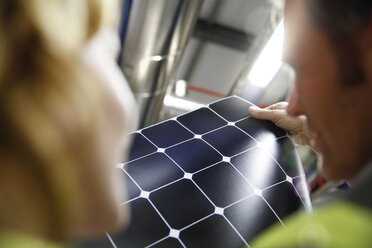 Colleagues examining innovative solar panel - FKF001768