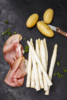 Raw potatoes and slices of raw ham, white asparagus and parsley - KSWF001743