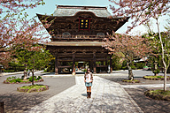Japan, Kamakura, woman standing in front of Kencho-ji temple - GEMF000801