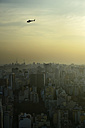 Brazil, Sao Paulo, cityview and helicopter in the evening - FLKF000644