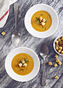 Soup dishes of creamed pumpkin soup with croutons and rosemary - RTBF000022