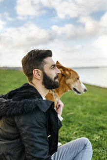 Man and his dog on a meadow - MGOF001609