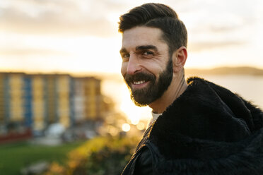 Portrait of bearded man at evening twilight - MGOF001621