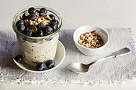 Glass of porridge with blueberries and chia seed - EVGF002882