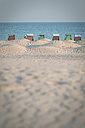 Germany, Warnemuende, beach with hooded beach chair - ASCF000533