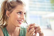 Portrait of smiling blond woman at outdoor cafe - ZOCF000023