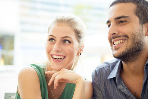 Portrait of smiling couple at outdoor cafe - ZOCF000026