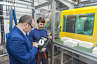 Manager and worker doing quality assessment in plastics factory - DIGF000107