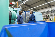 Manager and worker having work meeting in plastics factory - DIGF000137