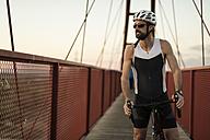 Racing biker on a bridge - JASF000564