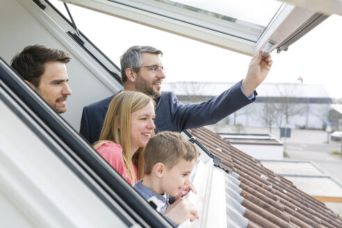 Family and estate agent looking through rooflight - SHKF000525