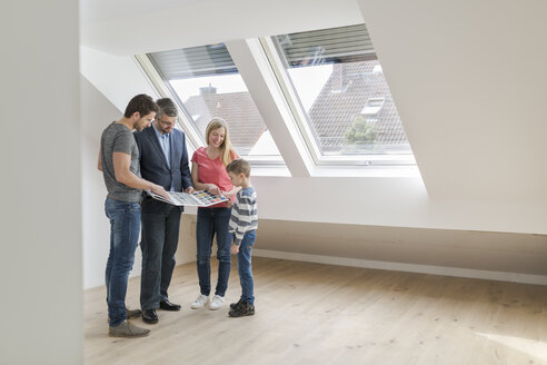 Estate agent showing family sample card in their new penthouse - SHKF000531