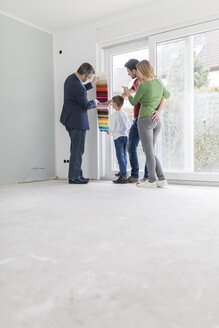 Estate agent showing family colour samples their new home - SHKF000540