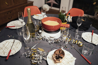 Laid table with cheese fondue for New Year's Eve party - MFF002923
