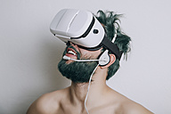 Shirtless man wearing Virtual Reality Glasses and headset - RTBF000058