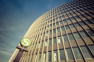 Germany, Berlin, office tower of Ernst and Young with sign of S-Bahn station Friedrichstrasse in the foreground - CMF000374