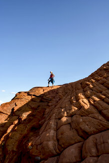 USA, Utah, Hiker in Snow Canyon State Park - LMF000570