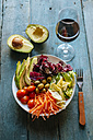 Mixed salad , sliced avocado and glass of red wine - KIJF000278