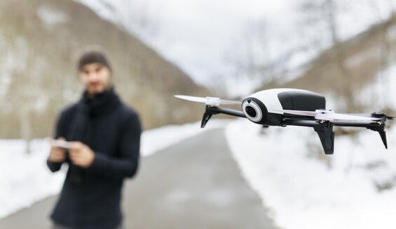 Man navigating a drone - MGOF001628