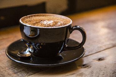 Brown coffee cup on wood - NGF000313