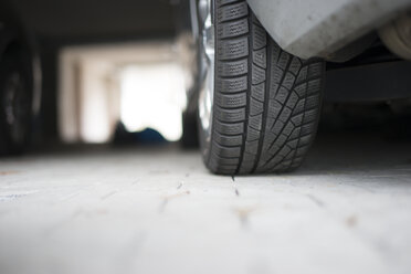 Germany, Car at underground car park, detail of tire - CHPF000225