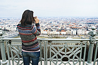 Hungary, Budapest, woman taking a picture from Gellert Hill - GEMF000812