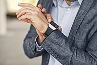 Close-up of businessman with smartwatch - MAEF011414