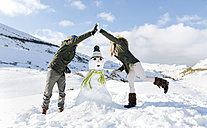 Spain, Asturias, couple with a snowman - MGOF001669