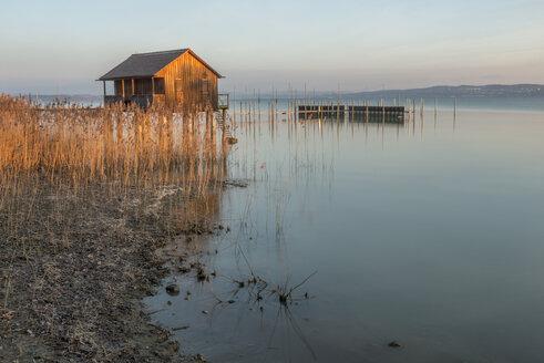 Switzerland, Thurgau, Altnau, Bathhouse at sunrise - KEBF000359