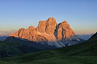 Italy, Province of Belluno, Dolomites, Selva di Cadore, Monte Pelmo at sunset - RUEF001670