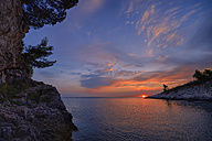 Croatia, Istria, Prematura, Adriatic Sea, Sunset at Cape Kamenjak - RUEF001676