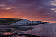 England, Sussex, View to Seven Sisters Chalk Cliffs at sunrise, Seven Sisters Country Park - RUEF001685