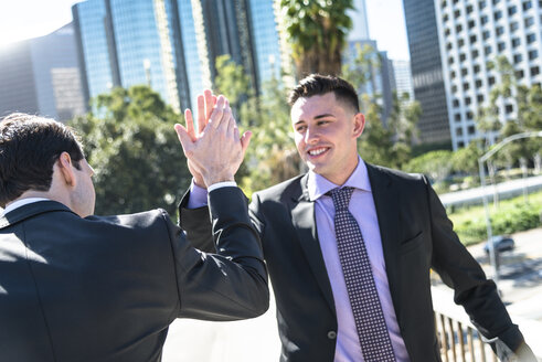 USA, Los Angeles, two businessmen high fiving - LEF000020
