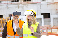 Two persons with Virtual Reality Glasses at construction site - MAEF011439
