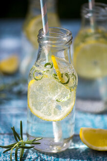 Slice of lemon and rosmary in water bottle, drinking straw - SARF002669