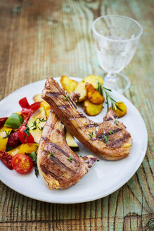 Lamb chops, potatoes and oven vegetables on plate - KSWF001750