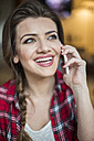 Young happy woman talking on the phone - HAPF000279