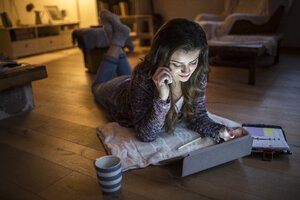 Young woman at home working with digital tablet - HAPF000297