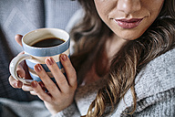 Young woman at home with cup of coffee - HAPF000303