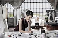 Wedding dress designer working - ZEF008628