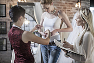 Wedding dress designer working, bride to be, measuring hip measurement - ZEF008643