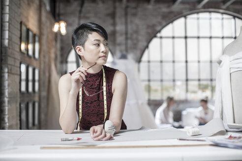 Wedding dress designer working - ZEF008658