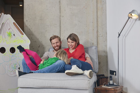 Happy family of three relaxing at home - RHF001382