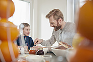 Father and son having breakfast - RHF001388