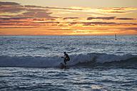 Man surfing at sunrise - SKCF000082