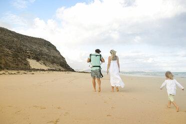 Spain, Fuerteventura, Jandia, family walking on beach - MFRF000603