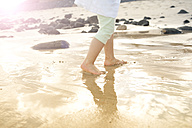 Girl walking in shallow water - MFRF000606